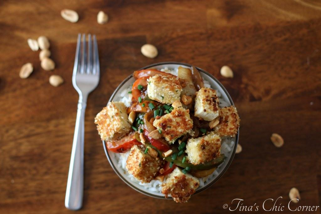Sesame Crusted Tofu With Peppers And Onions In A Spicy Peanut Sauce